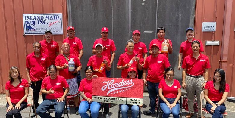 staff of Island Maid Inc. and Harders Hawaii, wearing red shirts
