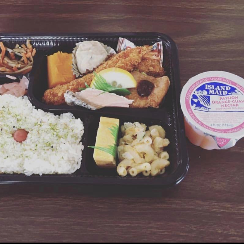 bento box lunch with portion cup